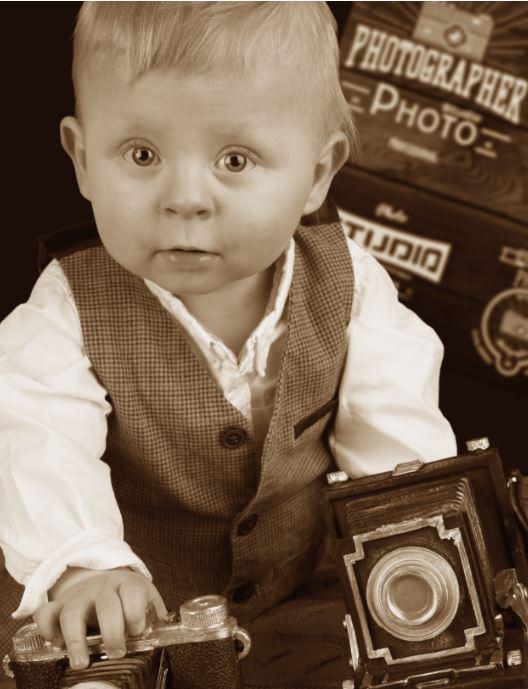Babyfoto mit Kamera